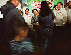 The Overseas Workers Welfare Administration, OWWA, holds one of their several holiday events throughout the Philippines to welcome the roughly 120,000 OFWs that came home for the Christmas season in Manila, Philippines on Dec. 2006.  Even President Gloria Macapagal-Arroyo took time out of her busy schedule to greet returning OFWs at the Ninoy Aquino International Airport.