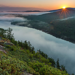 Fog and Echo Lake at sunrise in Maine's Acadia National Park.