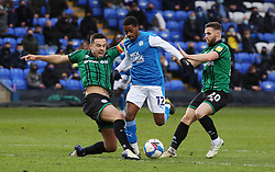 Reece Brown of Peterborough United takes on Eoghan O'Connell and Jimmy Ryan of Rochdale - Mandatory by-line: Joe Dent/JMP - 12/12/2020 - FOOTBALL - Weston Homes Stadium - Peterborough, England - Peterborough United v Rochdale - Sky Bet League One