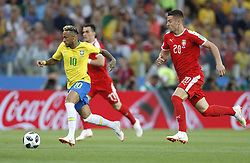 MOSCOW, June 27, 2018  Neymar (front) of Brazil breaks through with the ball during the 2018 FIFA World Cup Group E match between Brazil and Serbia in Moscow, Russia, June 27, 2018. (Credit Image: © Cao Can/Xinhua via ZUMA Wire)