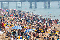 © Licensed to London News Pictures. 26/08/2019. Brighton, UK. Thousands of people to take to the beach and in Brighton and Hove on the August Bank Holiday Monday as hot and sunny weather continue to hit the seaside resort. Photo credit: Hugo Michiels/LNP