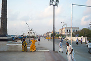 A woman stretches on the promenade during her morning exercise, Pondicherry, India<br /> Pondicherry now Puducherry is a Union Territory of India and was a French territory until 1954 legally on 16 August 1962. The French Quarter of the town retains a strong French influence in terms of architecture and culture.