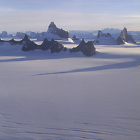 ANTARCTICA, Queen Maud Land. Fenris Mountains. Holtedahl Mountains distant bkg. Highest point is 2931m Ulvetanna.