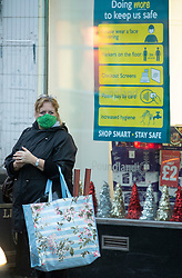 © Licensed to London News Pictures. 26/11/2020. <br /> Sevenoaks, UK. A lady out and about in Sevenoaks High Street in Kent this afternoon. Kent has been placed in tier three as the infection rate is among the worst in England. The health secretary Matt Hancock has announced the new toughened up tier measures today that will come into effect next Wednesday when England's month long lockdown comes to an end. Photo credit:Grant Falvey/LNP