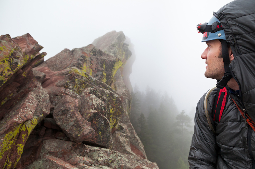 Obadiah Reid concentrates on a climb of the First Flatiron (Direct East Face, 5.6) above Boulder, Colorado.