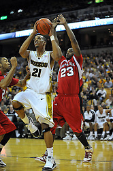 Jan 23, 2010; Columbia, MO, USA; Missouri Tigers forward Laurence Bowers (21) goes up for a shot as Nebraska Cornhuskers forward Quincy Hankins-Cole (23) attempts to block in the second half at Mizzou Arena in Columbia, MO. Missouri won 70-53. Mandatory Credit: Denny Medley-US PRESSWIRE