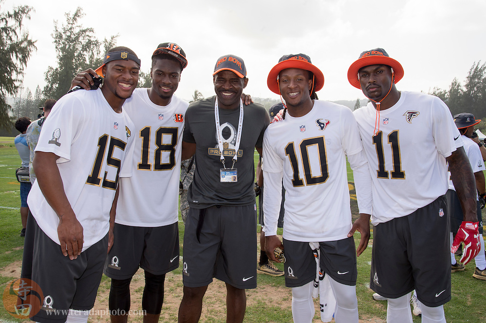 January 28, 2016; Kahuku, HI, USA; Team Irvin wide receiver Allen Robinson of the Jacksonville Jaguars (15), wide receiver A.J. Green of the Cincinnati Bengals (18), alumni captain Michael Irvin (center), wide receiver DeAndre Hopkins of the Houston Texans (10), and wide receiver Julio Jones of the Atlanta Falcons (11) pose for a photo during the 2016 Pro Bowl practice at Turtle Bay Resort.