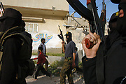 Militant members of Al Aqsa Martyrs' Brigade march down the streets of Gaza Strip as they conduct a military training on Martyrs' Day.