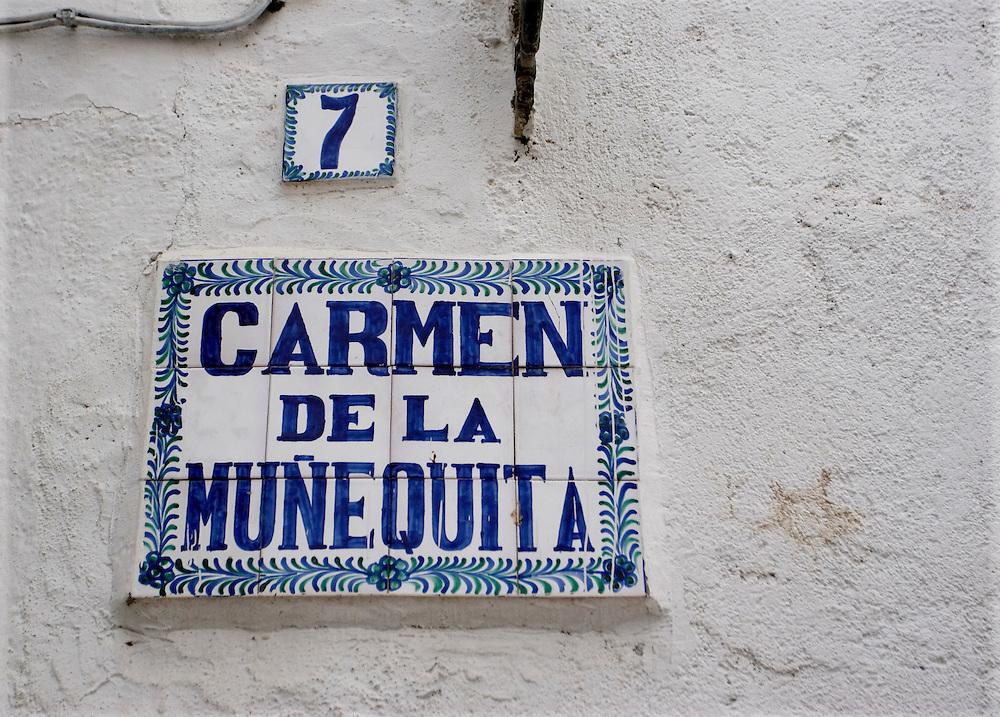 Carmen de la Muñequita street sign in Granada.<br /> <br /> Cartel de la Calle Carmen de la Muñequita en Granada.