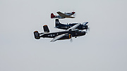 P-51 Mustang, AD-4W Skyraider, and B-25 Mitchell of Erickson Aircraft Collection flying formation at Airshow of the Cascades.