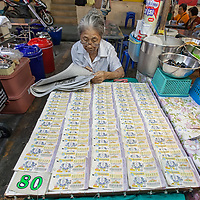 Woman selling lottery tickets in Hua Hin.