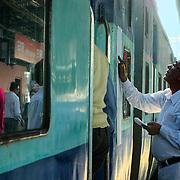 Worker preparing the passenger list for the next train