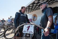Willie G. Davidson chats with Billy Lane in the pits before the start of Billy's Son's of Speed race during Daytona Bike Week. New Smyrna Beach, FL. USA. Saturday March 18, 2017. Photography ©2017 Michael Lichter.