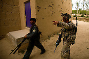 Soldiers of the 3rd platoon of the 10th mountain division during a fire fight with the taleban in the district center of Sharc in Logar province, Afghanistan on Tuesday, May 12th 2009...Photo: Guilad Kahn.