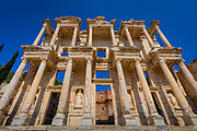 The library of Celsus is an ancient Roman building in Ephesus, Anatolia, now part of Selçuk, Turkey. It was built in honour of the Roman Senator Tiberius Julius Celsus Polemaeanus (completed in 135 AD) by Celsus' son, Gaius Julius Aquila (consul, 110 AD). The library was built to store 12,000 scrolls and to serve as a mausoleum for Celsus, who is buried in a crypt beneath the library.<br /> <br /> The interior of the library was destroyed, supposedly by an earthquake in 262 A.D., and the façade by another earthquake in the tenth or eleventh century A.D. It lay in ruins for centuries, until the façade was re-erected (anastylosis) by archaeologists between 1970 and 1978.