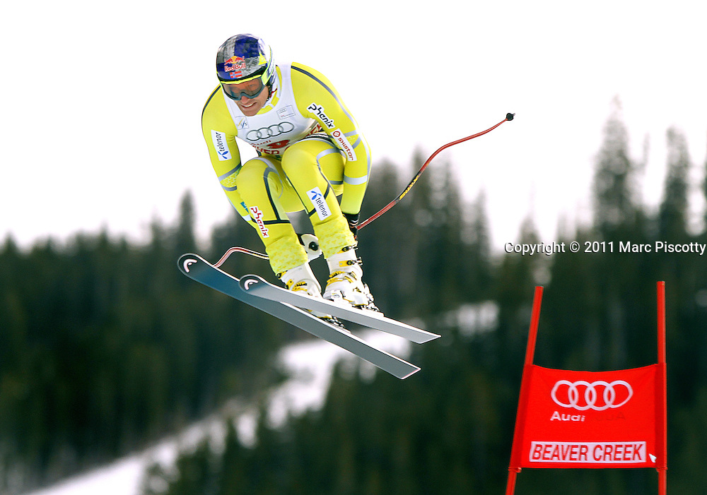 SHOT 12/2/11 12:22:49 PM - Nowegian skiier Aksel Lund Svindal takes flight off the Red Tail jump during the downhill on The Birds of Prey course at the Audi FIS World Cup on December 2, 2011 in Beaver Creek, Co. (Photo by Marc Piscotty / © 2011)
