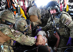 © London News Pictures. 11/06/11. AFGHANISTAN. The team work on a casualty. The RAF Regiment's Medical Emergency Response Team (MERT) is made up of two teams based in 'Main Operating Base Bastion', they are responsible for extracting casualties from anywhere within Helmand Province.  The MERT consists of a doctor, an emergency department nurse and two paramedics.  In addition four Royal Air Force Regiment gunners provide armed protection when they land and leave the helicopter to collect the casualty.   Caption must read Alison Baskerville/LNP...