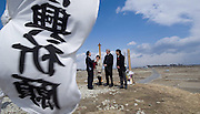 CORRECTS THAT PERSON AT RIGHT IS A TSUNAMI SURVIVOR -- Prime Minister Stephen Harper, third from left, and minister of International Cooperation Bev Oda, second from left, talk with Mayor Iso Sasaki, AND tsunami survivor Marshall Ikeda, right, as they visit the Yuriage Shrine in the coastal region of Sendai, Japan on Monday, March 26, 2012. The area was heavily impacted by the March 11, 2011, earthquake and tsunami. (AP Photo/The Canadian Press, Sean Kilpatrick)