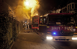 © Licensed to London News Pictures. 22/01/2012. London, U.K. Fire Officers deal with the fire. A London bus on Archway road catches fire. The bus was on it's way to the bus depot and no passengers were on the bus at the time. Traffic was affected in the area. Photo credit : Rich Bowen/LNP