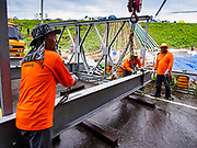 09 AUGUST 2018 - KAENG KRACHAN, PHETCHABURI, THAILAND: A construction crew works on an emergency spillway for the Kaeng Krachan Dam. The Phetchaburi River flows from Kaeng Krachan Dam to the Gulf of Siam through several towns including Ban Lat, Phetchaburi (the capital of Phetchaburi province) and Ban Laem. Government officials have warned residents of those towns that their towns will flood because the reservoir behind the dam is approaching capacity. Ban Lat and Phetchaburi could be flooded for several weeks. Residents of Ban Laem have been warned that their community could be inundated for over a month. Dams in Kanchanaburi province, west of Phetchaburi, are also approaching capacity and flooding is also expected in that area.   PHOTO BY JACK KURTZ