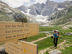 Woman hiking in the High Pyrenees in front of mount Vignemale, Cauterets, France