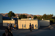 Parents and students walk through a patch of sun light in between classes during Milpitas High School's Back to School Night at Milpitas High School in Milpitas, California, on September 1, 2015. (Stan Olszewski/SOSKIphoto)