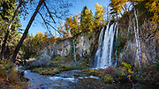 Little Spearfish Creek plunges over Spearfish Falls to meet the main Spearfish Creek. Walk the trail to Spearfish Falls for 1.5 miles round trip within Spearfish Canyon Nature Area, managed by South Dakota Game, Fish & Parks. Multiple overlapping photos were stitched to make this panorama.