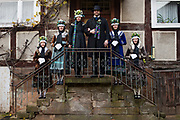 Nadine, member of the 'Trachtengruppe Wollmar' is wearing an original traditional bridal costume from Marburg (Marburger Tracht) in Wollmar, Hesse, Germany on November 12, 2016.<br /> <br /> From Left: Bridesmaid Tabea, Bridesmaid Maren, Bride Nadine, Groom Christoph, Bridesmaid Anika, Bridesmaid Elisa<br /> <br /> Only pristine women were allowed to wear the bridal crown.<br /> <br /> This is part of the series about Traditional Wedding Gowns from different regions of Germany, worn by young members of local dance groups and cultural associations that exist to preserve and celebrate the cultural heritage. The portraiture series is a depiction of an old era with different social values and religious beliefs in an antiquated civil society with very few of those dresses left.