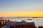 View of New York Harbor and the Staten Island Ferry, with the Statue of Liberty.