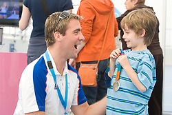 ODA Open House weekend. Leon Taylor Olympic silver medalist shows his medal off to the visiting public. Picture taken on 21 Sep 2008 by David Poultney.