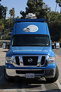 An ABC7 Eyewitness News truck at the Los Angeles Dodgers Foundation 16th annual Thanksgiving Turkey Giveaway at Dodger Stadium, Thursday, Nov. 19, 2020, in Los Angeles.
