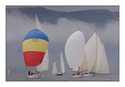Sonata 1950 Sloop, Solway Maid 1940 Bermudan Cutter and Mariquita 1911 a 19 metre with Misty Dunoon hills in background...Sunday race from Largs to Rhu started damp but briefly lifted for a downwind race to the upper Clyde...* The Fife Yachts are one of the world's most prestigious group of Classic .yachts and this will be the third private regatta following the success of the 98, .and 03 events.  .A pilgrimage to their birthplace of these historic yachts, the 'Stradivarius' of .sail, from Scotland's pre-eminent yacht designer and builder, William Fife III, .on the Clyde 20th -27th June.   . ..More information is available on the website: www.fiferegatta.com . .Press office contact: 01475 689100         Lynda Melvin or Paul Jeffes