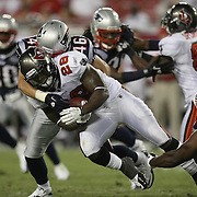 Tampa Bay running back Kregg Lumpkin (28) runs past Niko Koutouvides (46) and Landon Cohen (65) during an NFL football game between the New England Patriots and the Tampa Bay Buccaneers at Raymond James Stadium on Thursday, August 18, 2011 in Tampa, Florida.   (Photo/Alex Menendez)