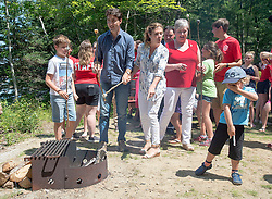 Hadrien Trudeau, right, reacts to the campfire smoke as his brother Xavier, father Prime Minister Justin Trudeau and his mother Sophie Gregoire, left to right, roast marshmallows at the Out and About Day camp at the Islands Provincial Park in Shelburne, N.S., Canada, on Friday, July 21, 2017. Photo by Andrew Vaughan/CP/ABACAPRESS.COM