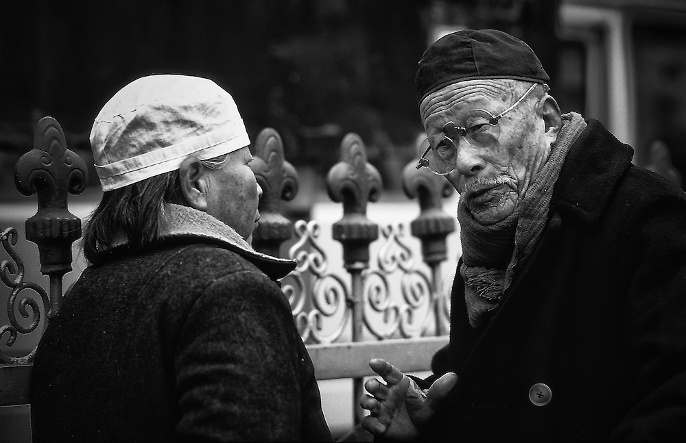Two old people talking in Xian's streets, 1986, China.