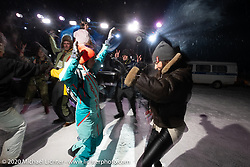 Oksana Voevodina dancing (in 6 degree F/ -14.5 C weather) with Bene Zaccherini on Lake Baikal with friends at the wrap party after the close of the Baikal Mile Ice Speed Festival. Maksimiha, Siberia, Russia. Saturday, February 29, 2020. Photography ©2020 Michael Lichter.