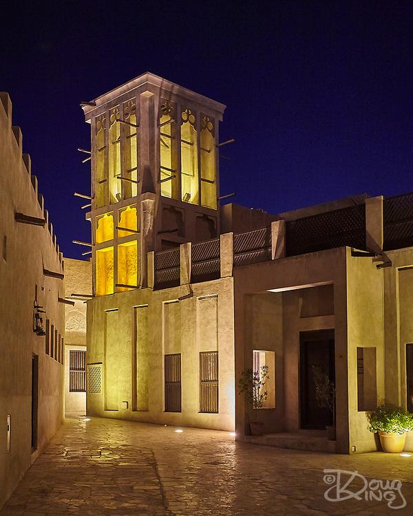 Historic Houses in the Bastakiya Quarter, Dubai are colourfully lit at night.