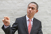 GUANGZHOU, CHINA - OCTOBER 02: (CHINA OUT)<br /> <br /> Chinese Obama Imitator<br /> <br /> Xiao Jiguo who is famous for imitating American President Obama poses After make up on October 2, 2015 in Guangzhou, China. Xiao Jiguo, born in Sichuan province, was well-known as an imitator of American President Barack Hussein Obama after acting in a Chinese entertainment program. He became a star among the commercial events and acted in a comedy during the Chinas National Day Holiday in Guangzhou.<br /> ©Exclusivepix Media