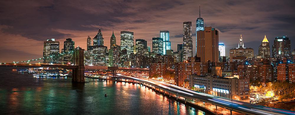 The scene over Lower Manhattan shortly after sundown, as seen from the pedestrian walkway of the Manhattan Bridge.