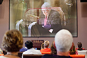 23 JULY 2009 -- PHOENIX, AZ: People listen to CBS commentator Andy Rooney eulogize Walter Cronkite Thursday. About 35 people gathered at ASU's Cronkite School Thursday to watch the live feed of the funeral of the school's namesake. Legenday CBS anchor Walter Cronkite died Friday, July 17. The picture was made as the TV image was fading from the casket to Andy Rooney.   PHOTO BY JACK KURTZ