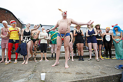 © licensed to London News Pictures. London, UK 07/12/2013. Swimmers getting ready to plunge into 7C degrees cold Parliament Hill, Lido swimming poll in north London during the December Dip event by Outdoor Swimming Society on Saturday, 7 December 2013. The poll temperature is 7C degrees. Photo credit: Tolga Akmen/LNP