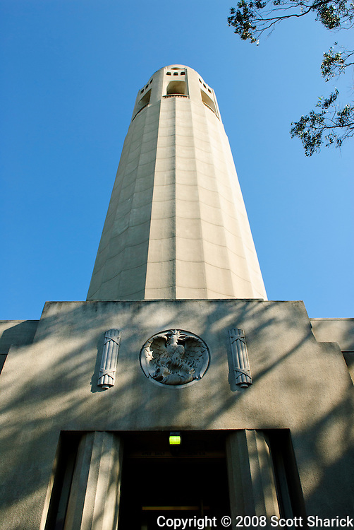 A vertical image of Coit Tower in San Francisco with a clear blue sky.
