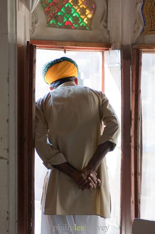 A guard looking out at Mehrangarh Fort in the city of Jodhpur, Rajasthan, India