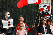 Members of the Belarussian community in Britain hold placards and banners with pictures of political prisoners during a demonstration outside Westminster Palace, Houses of Parliament in London on Sunday, Aug 8, 2021. Protestors joined by Polish people gathered to mark the 1st anniversary of the 2020 presidential elections, which opponents claim were rigged. Protestors also called Government in Britain to do more against the repressive regime of Lukashenko. (VX Photo/ Vudi Xhymshiti)