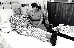 Nurse & elderly patient, Queen's Medical Centre, Nottingham UK March 1989