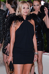 Kate Moss walking the red carpet at The Metropolitan Museum of Art Costume Institute Benefit celebrating the opening of Heavenly Bodies : Fashion and the Catholic Imagination held at The Metropolitan Museum of Art  in New York, NY, on May 7, 2018. (Photo by Anthony Behar/Sipa USA)