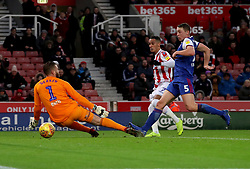 Stoke City's Tom Ince (centre) scores his side's first goal against Ipswich Town