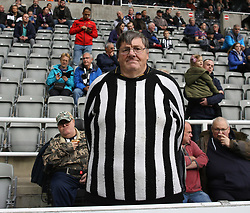 01 October 2017 Newcastle: Premier League Football: Newcastle United v Liverpool:  no replica jerseys for this Newcastle supporter, just a knitted black and white jumper.<br /> Photo: Mark Leech