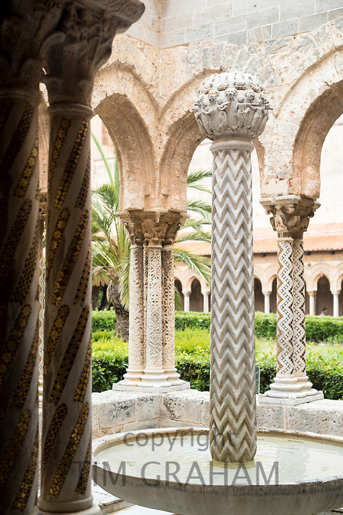 Cloisters columns and mosaics at cathedral Basilica Cattedrale Parrocchia Santa Maria Nuova in Monreale, Sicily