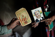 In Sarhad village, inhabited by Wakhis people, a woman shows me a picture of the Aga Khan, her living Imam, beside a picture of Prophet Ali. Wakhis are Ismaili muslims.